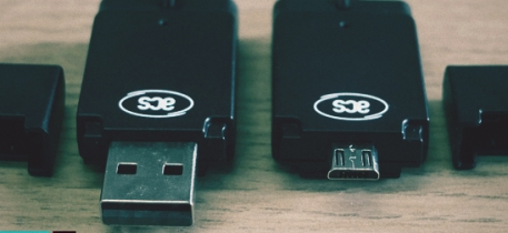 ACR39 USB stick readers on a desk