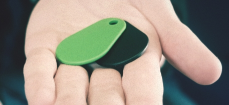 Hand holding thin contactless keyfobs