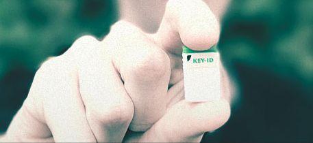 boy holding Key-ID FIDO U2f key
