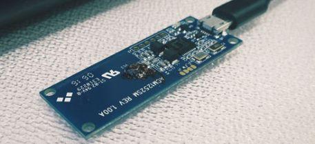 ACM1252U-Z2 USB NFC module connected to a laptop